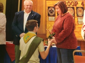 My Eagle Scout ceremony, I'm giving my mom a rose, and I'd say dad looks proud?
